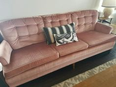 Mid-century pink velvet couch with wooden pin legs.  Thrift Store Hits || Champagne + Linen