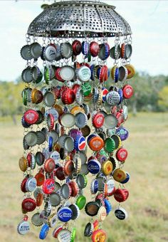 Vintage Decor Diy Bottle Cap wind chime idea - Wind chimes are one of the most popular garden ideas with some very different and unique designs. We bring you the 48 best DIY and upscale wind chimes.Windspiel für den Garten basteln mit Kronkorken u Crafts To Make, Fun Crafts, Pop Top Crafts, Carillons Diy, Garrafa Diy, Make Wind Chimes, Unique Wind Chimes, Homemade Wind Chimes, Bottle Cap Projects