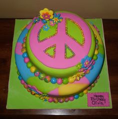 Groovy Peace Sign Birthday Cake for Izzy's birthday, possibly with colorful cake