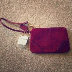 Coach Wrislet Small authentic Coach wristlet. Deep red/brown suede. Zipper closure. Perfect condition, never been used. Coach Bags Clutches & Wristlets