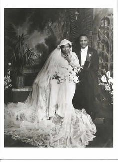 FOR BETTER OR WORSEFormal studio wedding portrait of an African American bride and groom. James Van Der Zee, photographer.