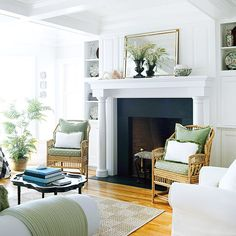pillars transform the fireplace into an elegant focal point for the room and help the fireplace stand out in front of the shelves. This gives emphasis to the fireplace instead of the shelving. Granite Fireplace, White Fireplace, Fireplace Design, Black Fireplace Surround, Fire Surround, My Living Room, Home And Living, Living Room Decor, Living Spaces
