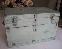 This chest was in rough shape! Much nicer now painted Duck Egg Blue chalk paint.  by Nelda Ream blog