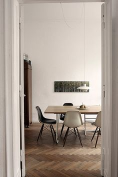 dining room with eames chairs and poulsen light