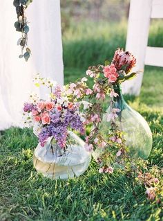 Summer wedding ceremony aisle marker idea - glass vessels filled with bright, wildflowers {Petals & Hedges}