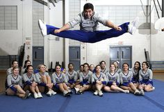 2/28/2013 Mike Orazzi | Staff  Bristol Eastern male cheerleader D'Avante Santiago poses with the rest of the cheerleading squad.