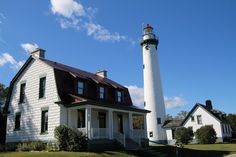 In the foreground is the 1905 House Museum, with the Lighthouse in the background.