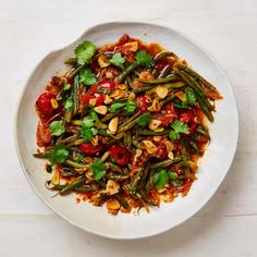 Yotam Ottolenghi's recipes for summery green side dishes | Food | The Guardian Ottolenghi Recipes, Yotam Ottolenghi, Vegetable Recipes, Vegetarian Recipes, Cooking Recipes, Food Dishes, Side Dishes, Braised Greens, Green Beans And Tomatoes