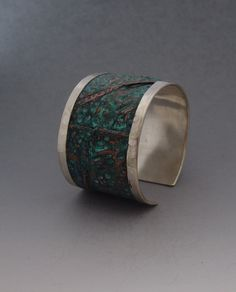 Handmade sterling silver and copper cuff bracelet,foldformed with blue-green patina.