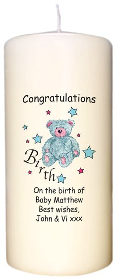 An ivory candle adorned with a cute blue teddy design along with any little boy's name and a personal message from you, making a unique gift to mark a special birth.
