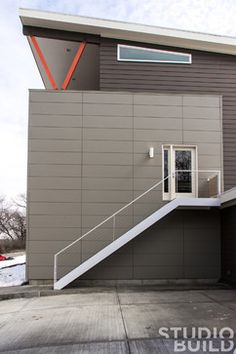 Hardie lap siding was paired with Nichiha cement fiber panels to create a low maintenance exterior skin. 1127 Residence - modern - exterior - kansas city - Studiobuild