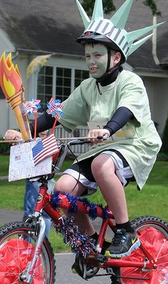 Boy Scout Troop 91 ride on bikes decorated in red, white and blue during the Harleysville Memorial Day Parade Saturday May 25, 2013. Souderton Independent photo — SUSAN KEEN