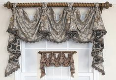 The Sophia Victory Swag touts a stunning latticework motif full of style and sheen. Available in plum or beige, this victory swag is a truly elegant look for any decor! Come on by to www.rlfhome.com and view the entire collection.