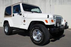 White Jeep Wrangler w/ Tan Hard Top