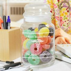 "Personalized Doctors Office Glass Candy Jars. Personalized Treat Jar also makes a wonderful, personalized gift for your favorite doctor as a thoughtful thank you gift. Your Engraved Doctors Office Candy Jar measures 5.5""H x 4""W and holds 26 oz. Each glass jar comes with an air-tight glass lid. Contents displayed in glass jar not included. Includes FREE Engraving. Personalize your Doctor Glass Jar with any name."