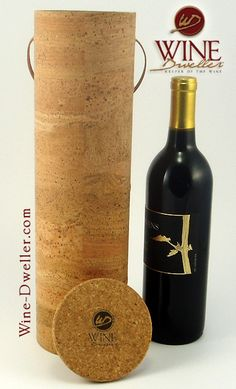 Keep your bottle snug with the all natural cork lid. The animal leather handle guarantees that you will be able to tote this bag comfortably and with ease. Each wine box holds a bottle of any beverage. Round Gift Boxes, Wine Gift Boxes, Wine Gifts, Bottle Cutting, Wine Brands, Wine Packaging, Cork Fabric, Wine Delivery, Personalized Wine
