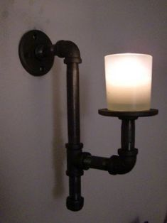 This awesome handmade industrial style sconce candle holder is made from black iron pipe and fittings. Pipe Lighting, Industrial Lighting, Industrial Style, Industrial Design, Lighting Design, Industrial Shop, Vintage Industrial, Ikea Industrial, Industrial Industry