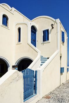 exterior white stucco with indigo blue trim