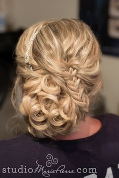 Off to the side updo with a fishtail braid and clip in hair extensions
