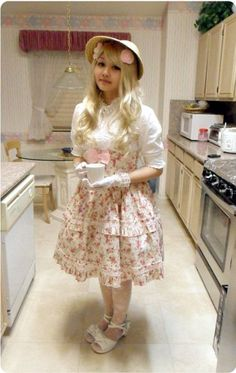 This is a sweet mix of Classic and Country Lolita outfit. It is very nicely put together co-ord.