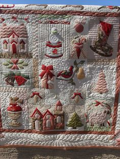 Christmas sampler - I do not do applique but I have a deep appreciation for those with those skills..send your quilts to ... lol