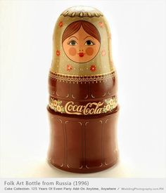 Folk art Coca Cola bottle designed in Russia on exhibit during 1996 Olympic Games in Atlanta. Nesting dolls.