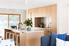 Modern minimalist kitchen with all wood cabinetry