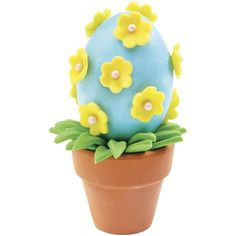 Spring Flower Easter Eggs - Show springtime in full flower! Plant a hard-cooked egg topped with pretty pastel blossoms in a fun flower pot for every guest.