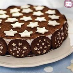 Torta pan di stelle Milk with a dash of coffee, nutella & cream. Make in a cake tin, refrigerate then border with pan di stelle biscuits & dust with cocoa.