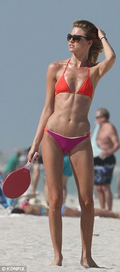 Beach tennis: Hunt managed to keep her eye on the ball and keep her tiny triangle two-piec...