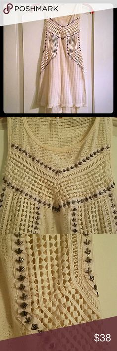 Free people dress top Cream/off white colored dress tank..with beaded details and woven fabric patterns! Super soft, lovely details! Layered back. From Nordstrom. Worn twice. Clean! Runs big I normally wear medium, I purchased XS. Free People Tops Tank Tops