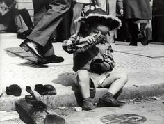 Unknown Photographer, NL  Child polishing shoes - Lissabon, Portugal, 1977