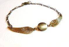 """Harry Potter Golden Snitch bracelet: """"To Harry James Potter, I leave the Snitch he caught in his first Quidditch match at Hogwarts as a reminder of the rewards of perseverance and skill."""""""