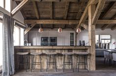 Kitchen with wooden ceiling and exposed beams in a rustic chalet
