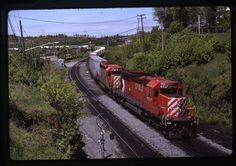 6037-5736 train 402 at Kenora, Ontario on 5/25/91.