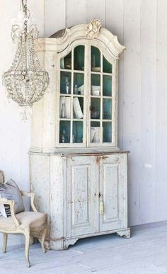 Eloquence Vintage step back cabinet, French chair & chandelier.