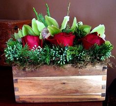 Christmas floral arrangement with orchids and roses.