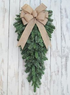 Christmas Teardrop Wreath with Burlap Bow. Rustic for winter and Christmas home and door decor, and gifts. Seasonal. Limited quantity available. - Multiple loop natural burlap bow - Artificial pine te