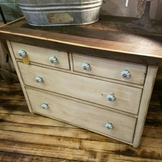 Antique white dresser with reclaimed wood top and blue knobs. $189.99 #cherisheverymoment #homedecor #upcycled