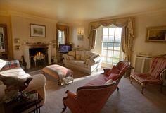 The Lounge. Squashy sofas, big sash windows and a roaring fire. www.emmettsgrange.co.uk
