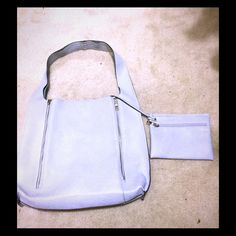 Free People Zipper Tote Sky blue. Zippers on both sides to expand. Wallet included. Large. I fit my laptop into it for school and maybe a book. No damage at all although it was used for a few months. Free People Bags Totes