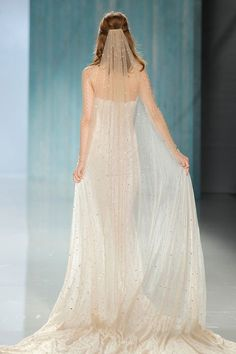 """Dramatic veil with sheath strapless wedding gown  // In our second feature on our favourite designers at Barcelona Bridal Fashion Week 2017 which we covered as an Official Media partner, we fix our gazes on Galia Lahav's bohemian Gala No. IV line and dramatic Victorian Affinity 2018 collection. The standout pieces for us on the catwalk? """"Thelma"""", a homage to Queen Victoria's wedding gown with sheer drape silk tulle sleeves and """"Liliya"""", a fairytale ball gown made of real silver twilight…"""