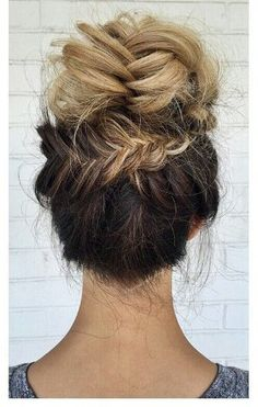 Blonde ombre fishtail braided updo bun hairstyle.  Click here to see more hairstyle ideas: http://www.amodernmomblog.com/2016/09/quick-hairstyles/