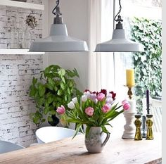 Beautiful exposed brick & industrial styled dining table lighting