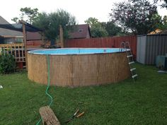 diy camoflauge above ground pool with bamboo or reed fencing