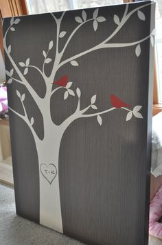 Beautiful canvas painting of a tree with our initials and 2 birds from www.redenvelope.com