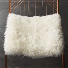 Shop icelandic sheepskin chair cover. Authentic Icelandic sheepskin layers natural, touchable texture as a super-soft chair pad. Cushy comfort and modern style sized to pad most CB2 dining chairs, bar stools or benches.