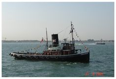 https://flic.kr/p/7e3cb1 | CHALLENGE | Photo taken 27 Jun 2005, Spithead, vessel pat of the Trafalgar Fleet Review , this was taken the evening before the review, which was just as well because excursion boats were penned in one edge of the Review on the day. Brief History of Challenge - Taken from Challenge Society WebPage  www.stchallenge.org 1931 Built for Elliott Steam Tug Co., London.  Lloyds Register of Shipping (LRS) 54844. Acquired by SHIP TOWAGE [LONDON] LIMITED 1-2-1950. Disposed…