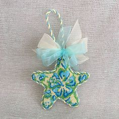 Starfish ornament finished off with matching yellow and blur twist cord and bows ~ Canvas by Associated Talents