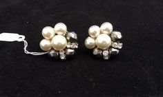 Check out this item in my Etsy shop https://www.etsy.com/listing/182197879/vintage-pearl-rhinestone-clip-on